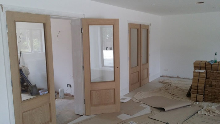 Project: 20 x Oak faced doors to be painted black