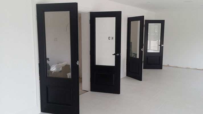 black painted oak looks with stark white walls and woodwork
